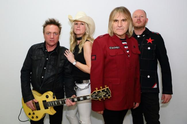 "The Alarm band members James Stevenson, Jules Peters Mike Peters and Steve ""Smiley"" Barnard"
