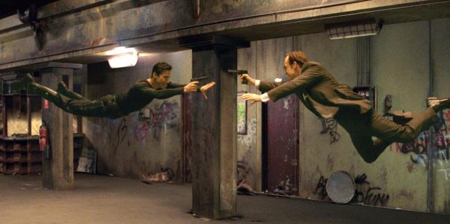 Keanu Reeves and Hugo Weaving in the unrgettable action epic. Picture: Facebook/ The Matrix
