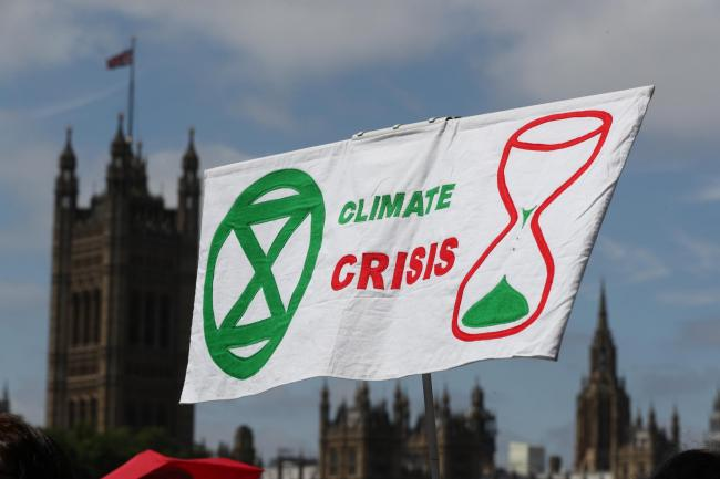 A banner reading Climate Crisis in London