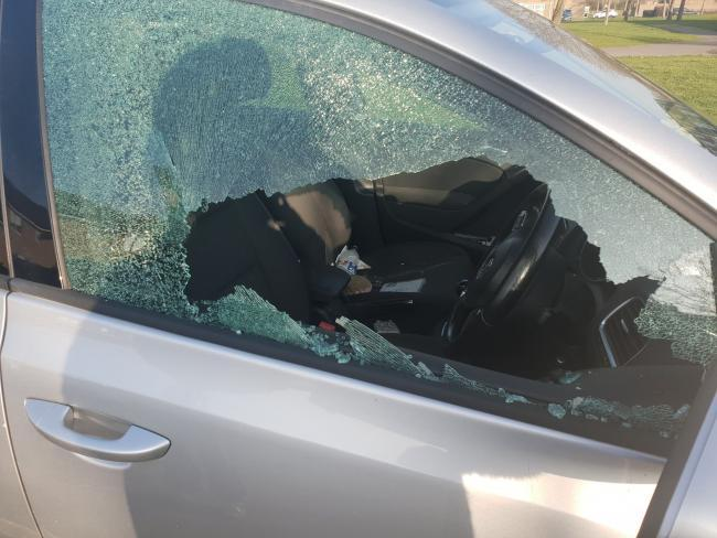 One of the broken car windows
