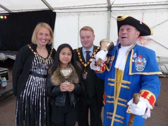 Mayor and Mayoress of Llandudno, cllr Dave and Amanda Hawkins with last year's winner Sian Sumang and Town Cryer Billy Baxter