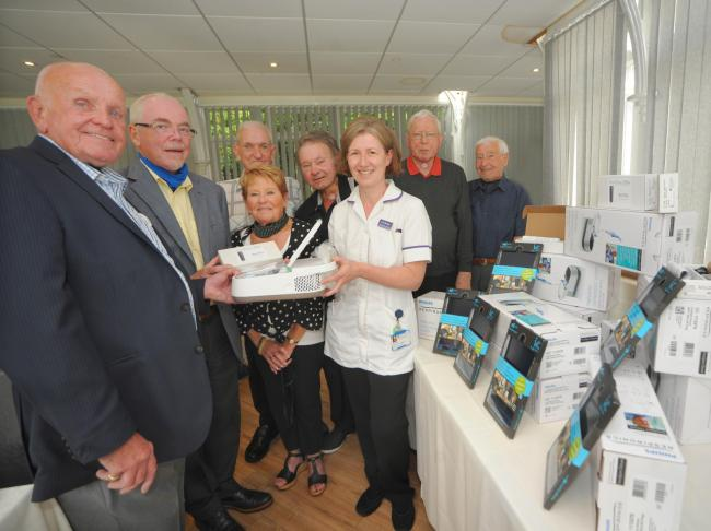 Peter Holloway presenting speech and language therapist Liz Thomas with the new equipment. Picture: Phil Micheu