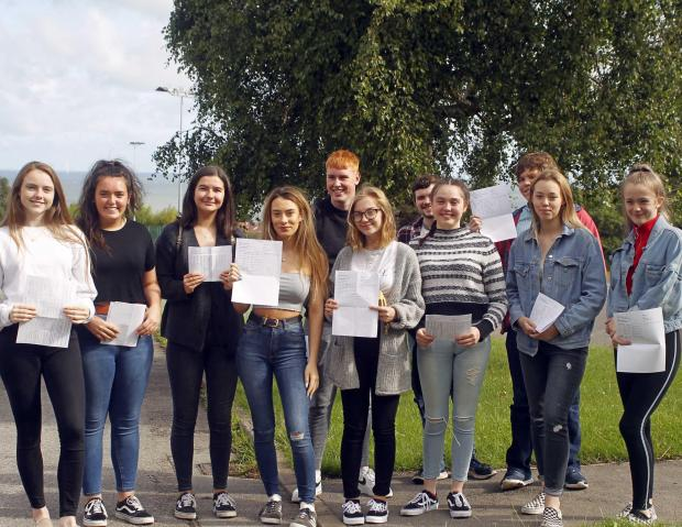 North Wales Pioneer: A group of pupils (year 12) with their results at Ysgol Bryn Elian. Picture: Dave Thomas
