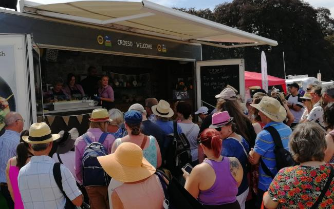 Consumers sampling PGI Welsh Lamb at HCC's mobile cooking theatre