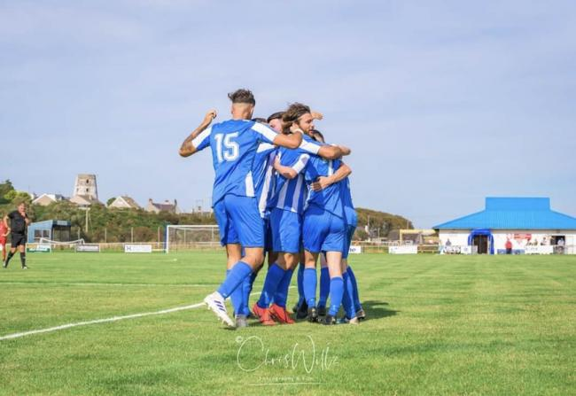 Holyhead Hotspur celebrate their late winner against Denbigh Town