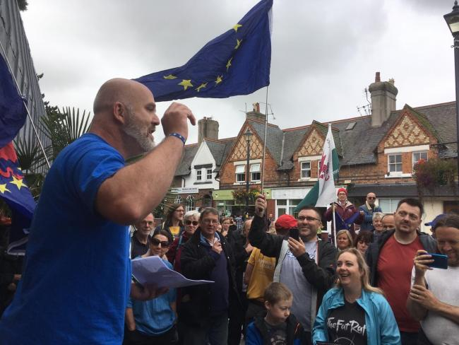 Jason Edwards addressing the demonstration in Colwyn Bay