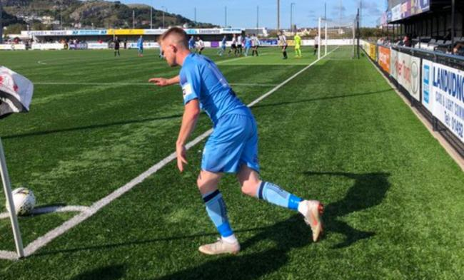 Corrig McGonigle takes a corner for Conwy Borough at Llandudno
