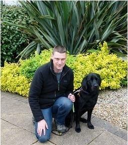 Ricki Owen of Colwyn Bay and his guide dog Barney