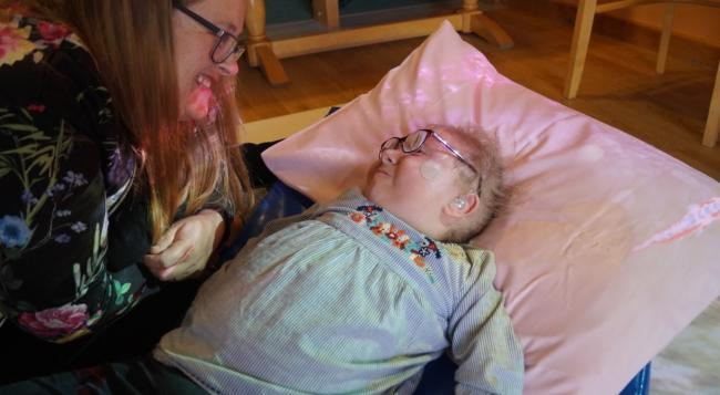 Seren – Seren Williams, 5, from Kinmel Bay and T? Gobaith Playleader Diane Lloyd explore the Magic Carpet