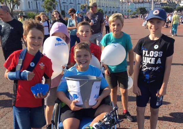 Harri, 10, with his friends on the sponsored walk