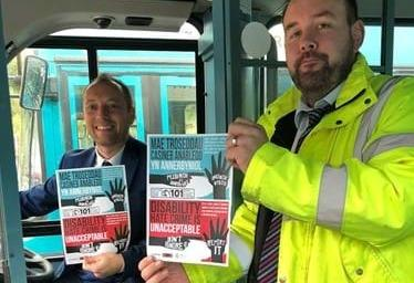 Greg George, NWP head of diversity and Anthony Holyfield, Arriva Buses' operational manager for North Wales. Picture: North Wales Police