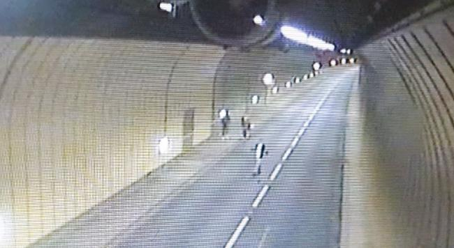 A pedestrian was caught on CCTV walking in the middle of the 70mph carrigeway. (Source - Welsh Government)