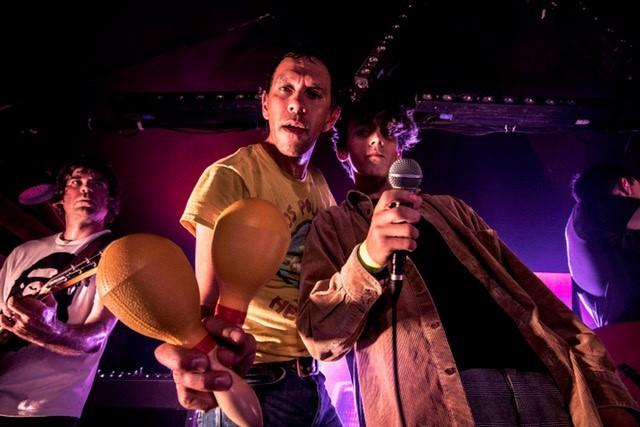 Frontman Rick Witter and son Duke on stage during a Shed Seven concert. Picture: Barnaby Fairley