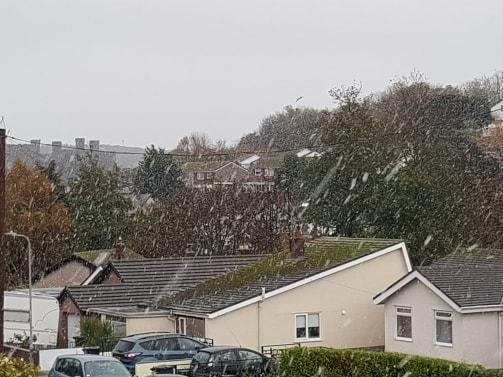 Snow falling in Conwy this morning.