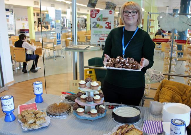 Doti Young, the college's higher education student union president selling her homemade cakes to raise money for Mind, the college's chosen charity for the 2019-2020 academic year.