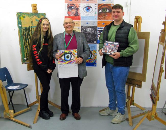 Arts students Sade Cockbill (from Prestatyn) and Connor Williams (from Rhyl) with Arthur Airey.
