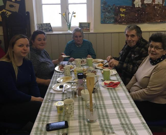 People enjoy an FUW farmhouse breakfast