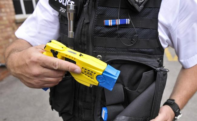 Library image of police issuing Taser