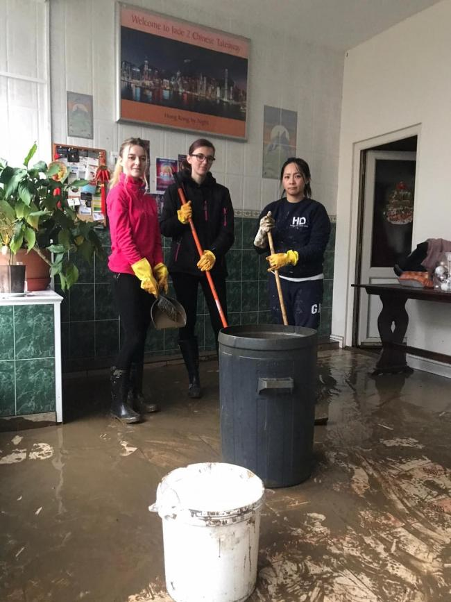 Donna Yu and staff cleaning up a Chinese takeaway after the flooding. Picture: Kerry Roberts
