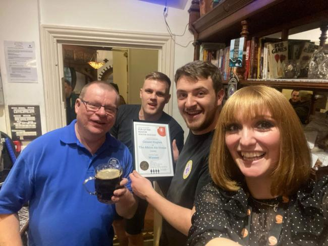 Abercolwyn CAMRA Chairman Ian Saunders,  Dylan Hughes, licensee Geraint Hughes and Helena Gull with their award