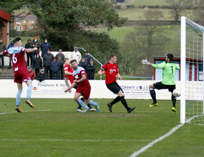 Mitch Bryant opens the scoring for Colwyn Bay (Photo by Dave Thomas)