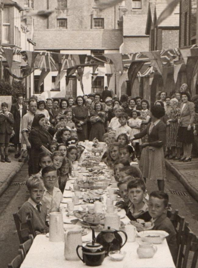 A VE Day party on Taliesin Street, Llandudno . The Victory Queen was a little girl called Patricia Meredith whose father was killed in North Africa while serving with the local battery of the Royal Artillery