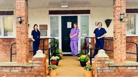 Manager Sam Leuty (left), team leader Kerry Whiteley (centre) and deputy manager Sharon Jones (right) outside the home in Kinmel Bay