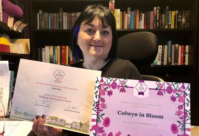 Ingrid Lewis, chair of Colwyn in Bloom with the award certificates