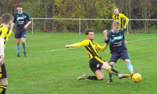 Action from St Asaph City's friendly win over Kinmel Bay (Photo by Richard Bates)
