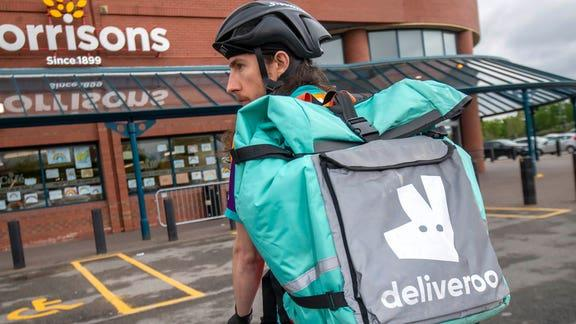 UberEats and Deliveroo drivers campaign for better work rights. (PA)
