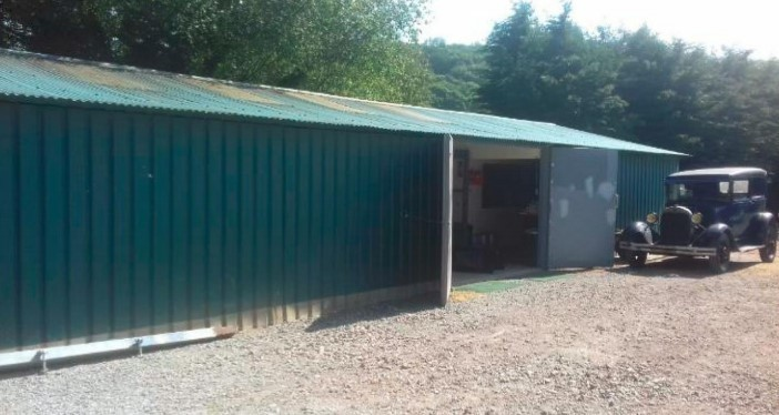 The former nursery packing shed with one of Mr Dyche\s vintage Ford cars Picture: In planning documents (clear for use by all partners)