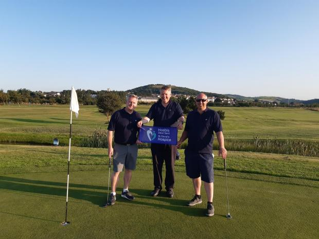 North Wales Pioneer: (L-R) Simon Neville, Adrian Owen and Chris Curry after completing their 50-hole golf challenge at Rhos-on-Sea Golf Club