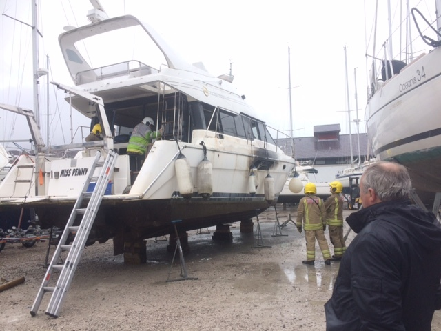 Fire crews continue examine the incident on Miss Penny at the Conwy Marina. Picture:Kerry Roberts