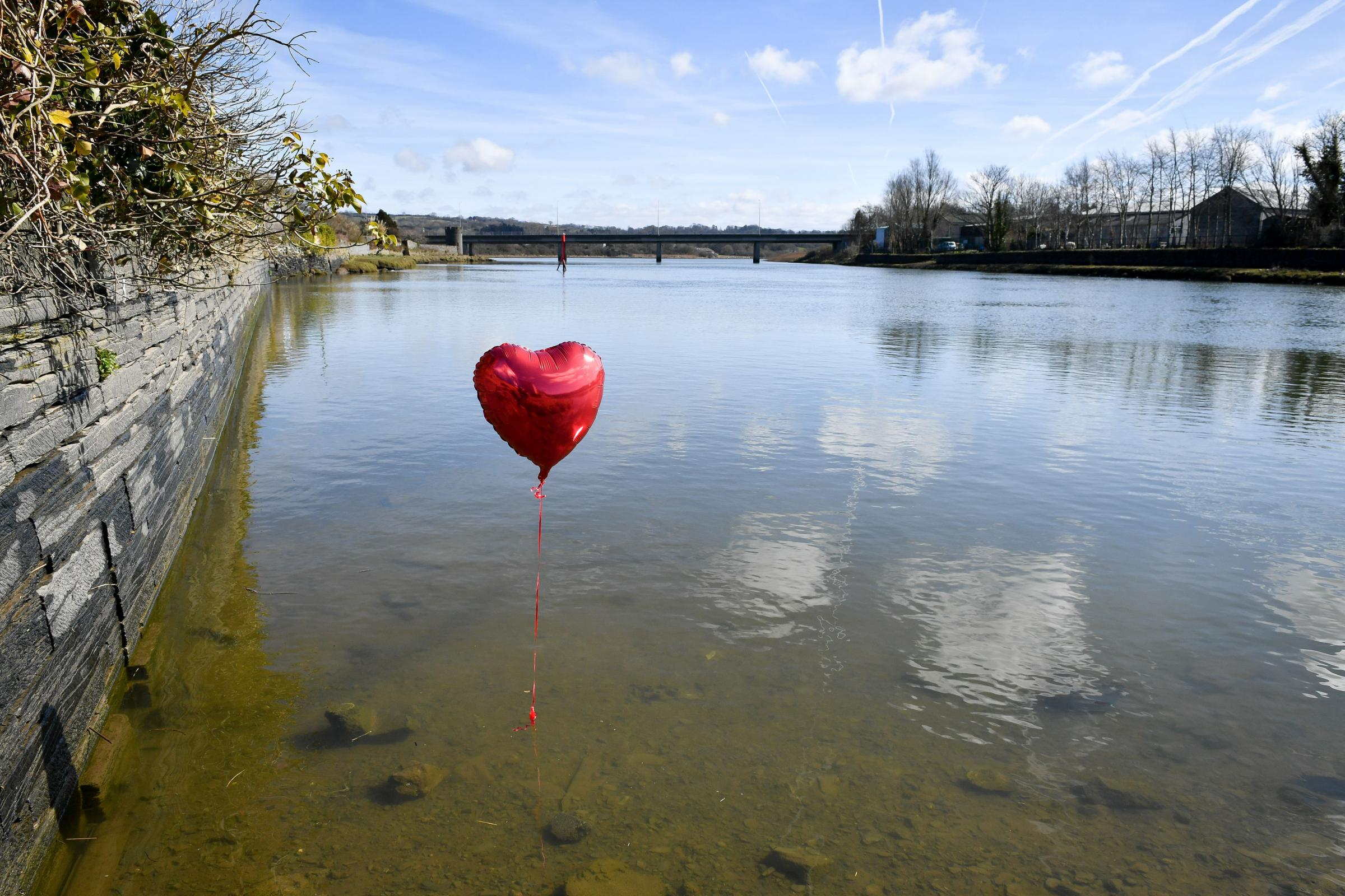 A red balloon in the River Teifi in Cardigan, Wales, near the scene where two-year-old Kiara Moore was recovered from a car that had plunged into the river. Picture: PA / Ben Birchall