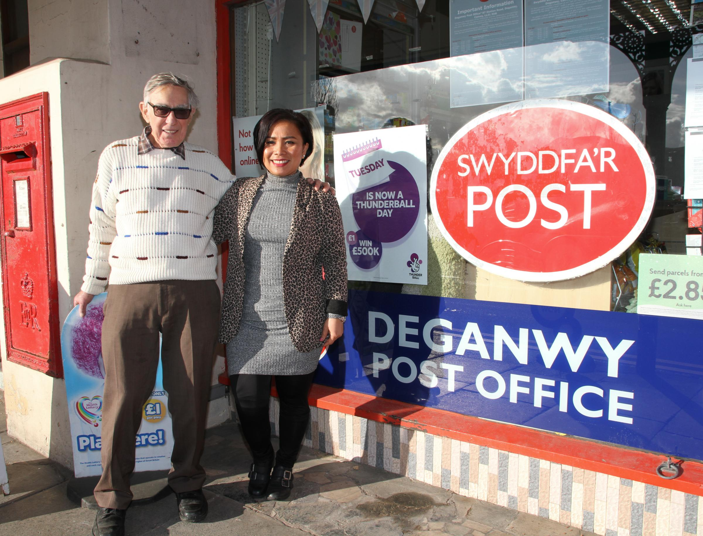 John McEwen and Roseerna Silalahi at the Deganwy Post Office. Picture: Kerry Roberts, KR150318j