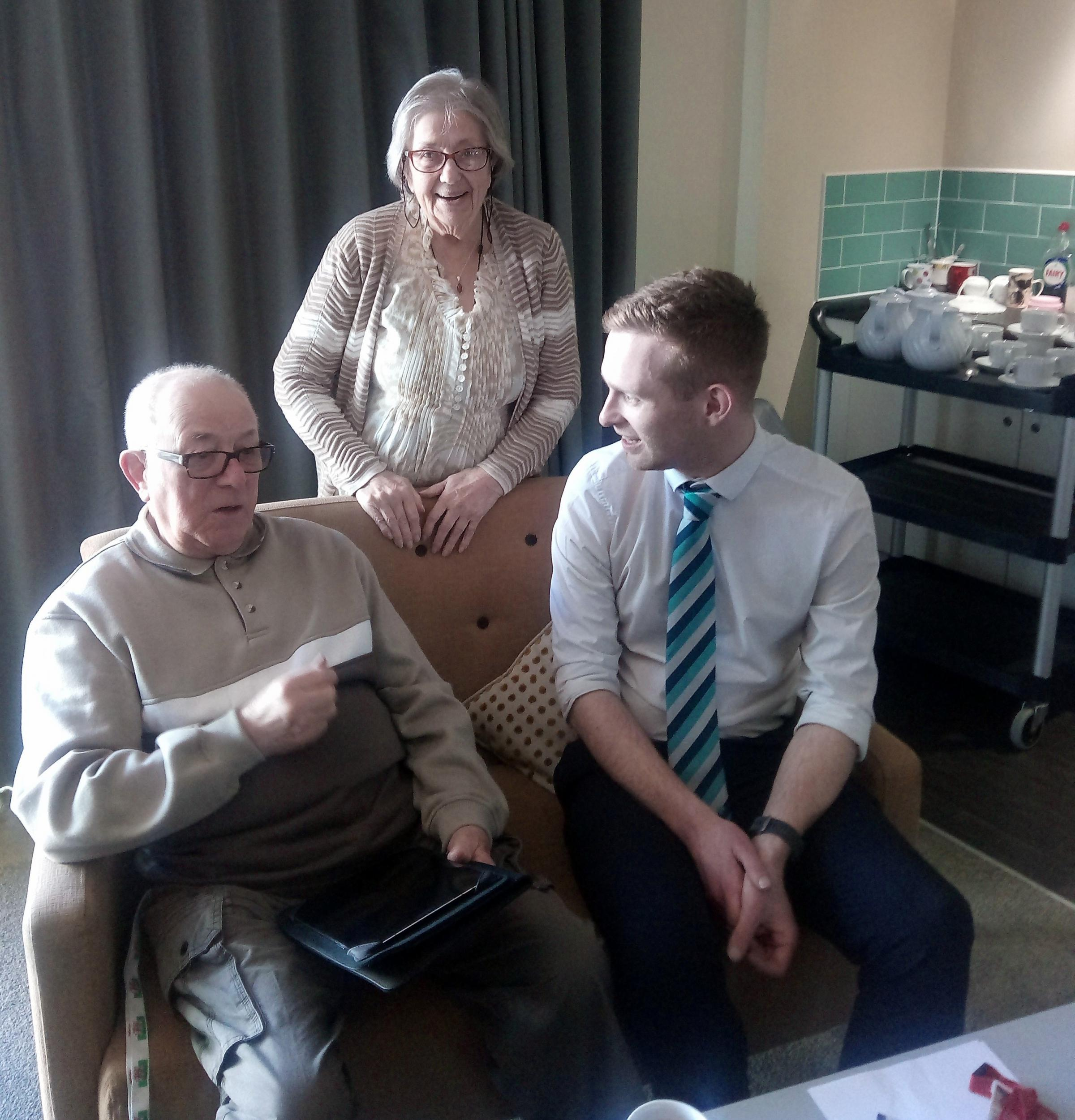 Tan y Fron Extra Care tenants Malcolm Henderson and Hilda Aigbogun with Barclays community banker Josh Jones.