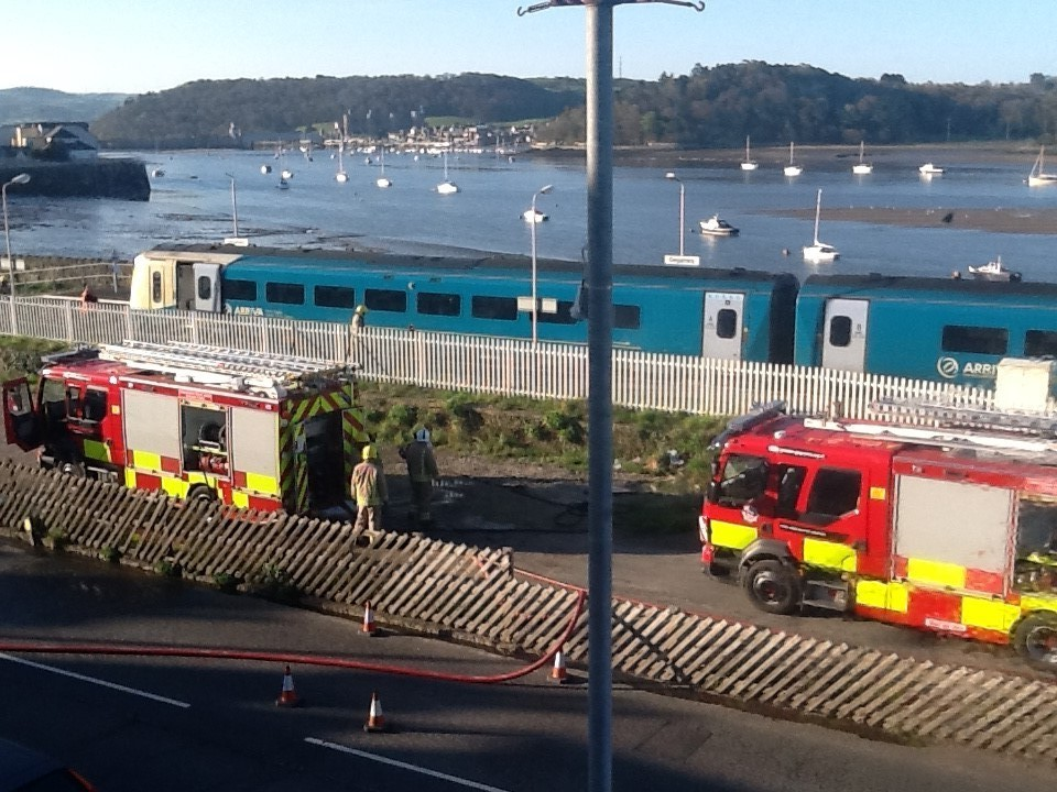 A train carriage caught fire on Saturday while at the Deganwy station