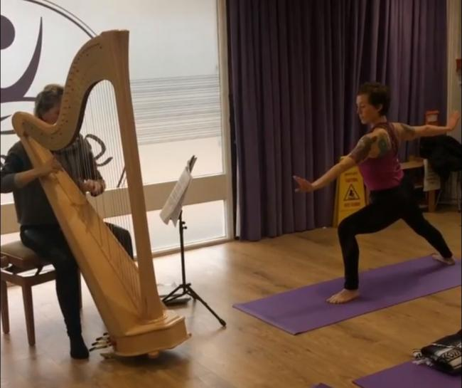Helen Wyn Pari and Samantha Hare practice for the harp yoga sessions they run