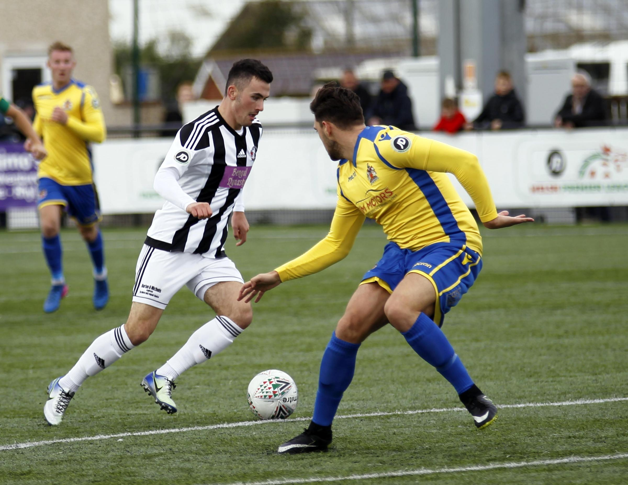 Llandudno forward John Owen on the attack (Photo: Dave Thomas)