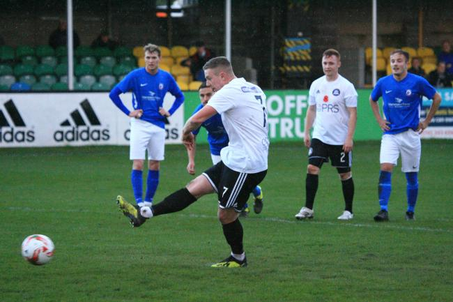 Kristian Pierce scores for Rhyl against Caersws (Photo: Gareth Hughes)