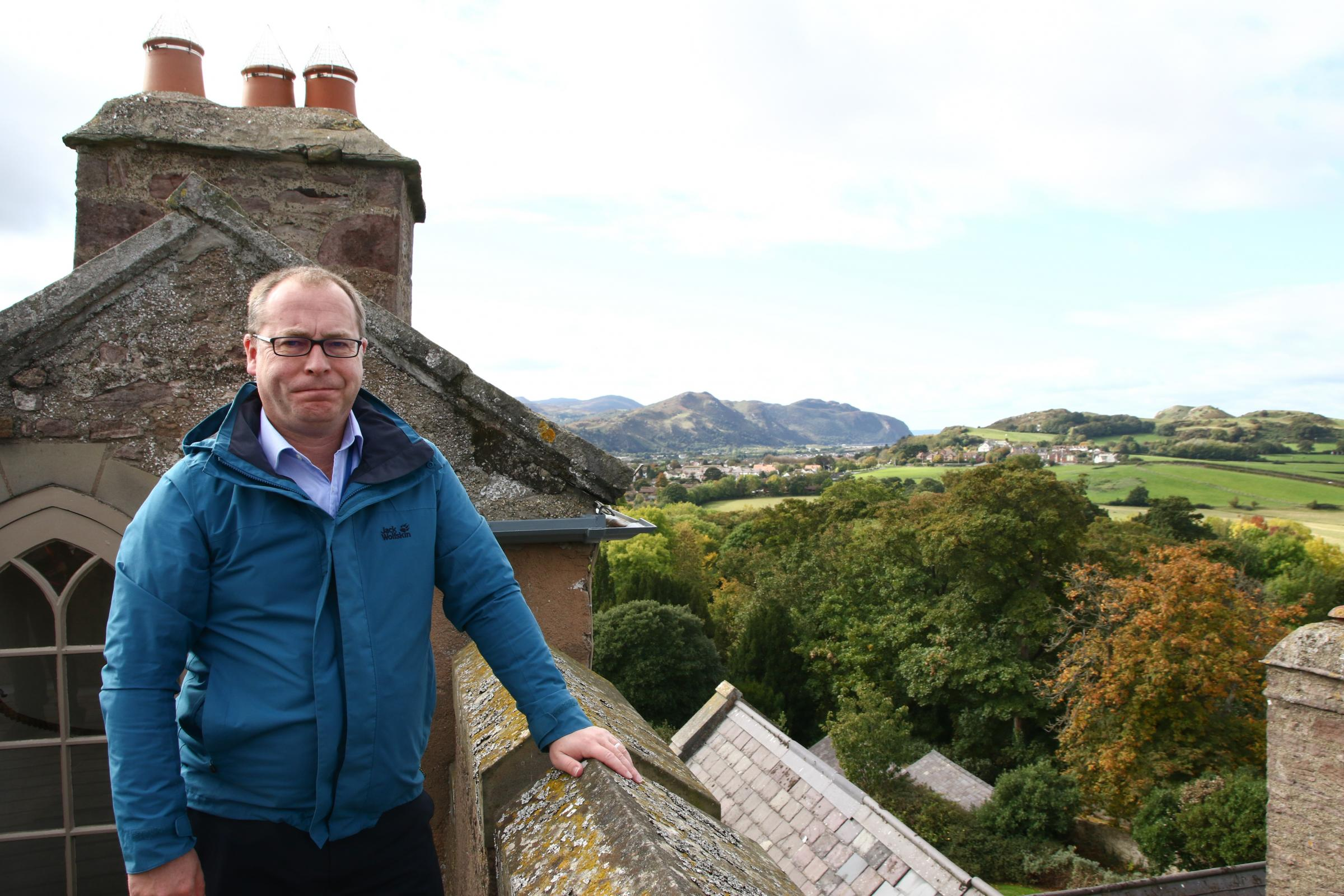 The planning inspector Mr Iwan Lloyd overlooking the site from Bodysgallen Hall
