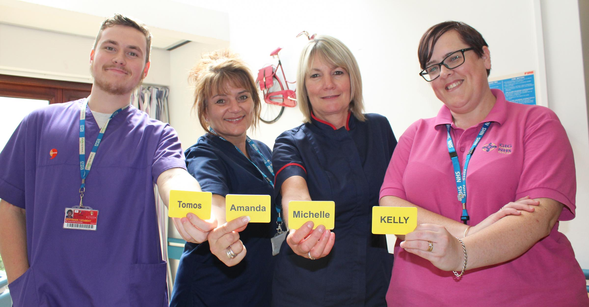 Staff on Cemlyn ward, where research took place, with the new badges