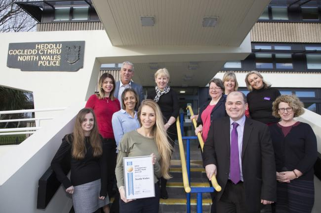 Office of the Police and crime commissioner for North Wales with the OPCC Transparency Quality Mark award for 2017/18. Pictured is Gemma Jennings with the award and the OPCC team.