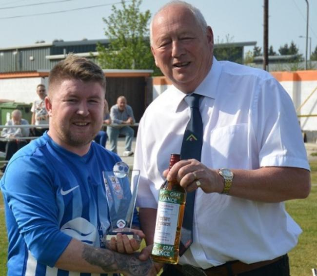 Mel McGinness receiving his Huws Gray Alliance Player of the Year Award