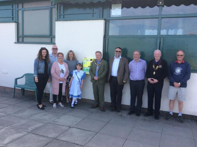 Llandudno Cricket Club officials with Llandudno Mayor David Hawkins and the new defibrillator