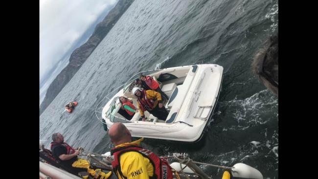 The family being transferred onto the Llandudno lifeboat. Picture RNLI