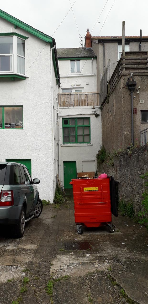 North Wales Pioneer: The rear of the Sue Ryder shop, the intruder broke in through the green door. Picture: Kerry Roberts
